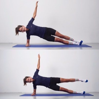 A young woman on a yoga mat doing core stability work