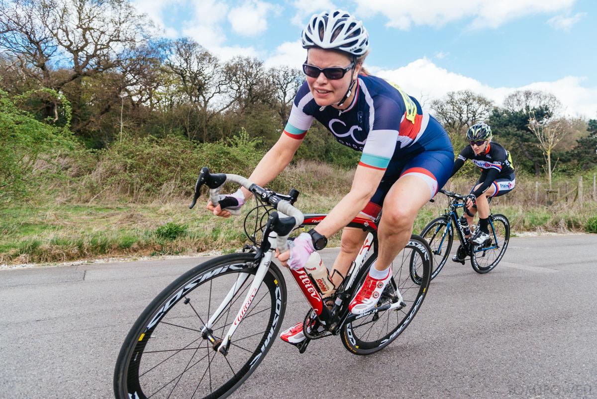 a woman on a bike corners sharply to the left